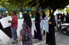 Parents gather outside GDh Thinadhoo's atoll education centre to protest the impending termination of two teachers who took part in an opposition political rally.