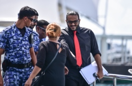 Ex-VP Ahmed Adheeb escorted back to Dhoonidhoo detention centre after his preliminary hearing at the Criminal Court. PHOTO: HUSSAIN WAHEED/MIHAARU