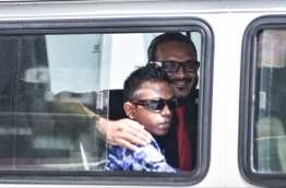 Ex-VP Ahmed Adheeb pictured inside a police vehicle as he is escorted back to Dhoonidhoo detention centre after his preliminary hearing at the Criminal Court. PHOTO: HUSSAIN WAHEED/MIHAARU