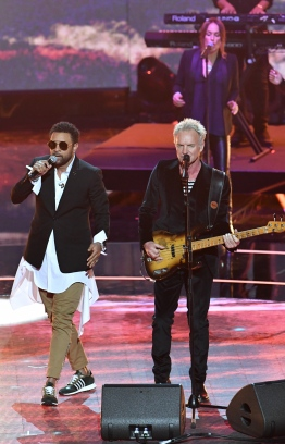 (L-R) US musician Shaggy and British musician Sting perform at The Queen's Birthday Party concert at the Royal Albert Hall in London on April 21, 2018 on the occassion of Britain's Queen Elizabeth II's 92nd birthday. / AFP PHOTO / POOL / John Stillwell