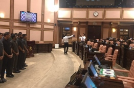 Security officers surround Speaker Maseeh inside the parliament chambers, seen on the left. PHOTO: AHMED NIHAN