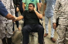 Opposition Jumhoory Party (JP) leader Qasim Ibrahim being taken to Velana International Airport (VIA) by Maldives Correctional Service (MCS) officers. He was given permission to depart to Singapore on Wednesday evening.