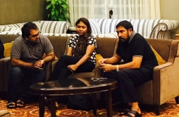 Qasim Ibrahim (R) with his lawyers at the VIP lounge in Velana International Airport (VIA) before departing to Singapore.