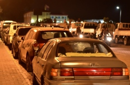 Cars pictured parked alongside a pavement in Male City. PHOTO / MIHAARU