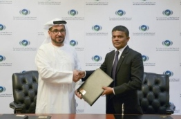 Ambassador of the Maldives to the UAE, Dr Hussain Niyaz, and ADFD's Director General Mohamed Saif Al Suwaidi shake hands after signing the agreement for Abu Dhabi Fund to donate USD 500,000 to the Maldives for its developmental projects.