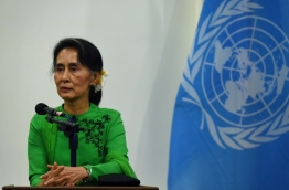 "Myanmar's de facto leader Aung San Suu Kyi on September 6, 2017 alleged a ""huge iceberg of misinformation"" was distorting the picture of the Rohingya crisis, which has forced 125,000 of the Muslim minority to flee to Bangladesh. / AFP PHOTO / ROMEO GACAD"