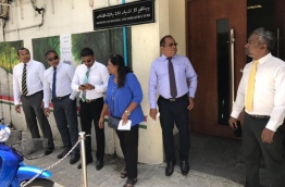 Lawmakers and Male City Councillors pictures outside the housing ministry. PHOTO: NISHAN ALI/MIHAARU