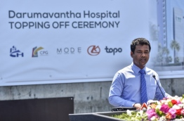 """Health Minister Abdullah Nazim speaking at the topping off ceremony of the new 25-storey """"Dharumavantha Hospital"""" located at the capital Male. MIHAARU PHOTO / HUSSEN WAHEED"""
