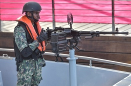 A solider pictured at an artillery aboard an MNDF naval vessel. PHOTO: NISHAN ALI/MIHAARU