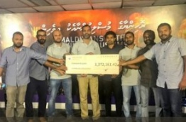 Staff of MPL pose with a cheque of MVR 1.3 million donated to the Maldivians With Rohingya fund. PHOTO/MPL