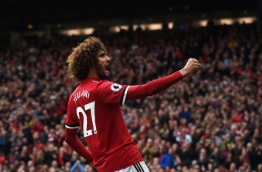Manchester United's Belgian midfielder Marouane Fellaini celebrates scoring the team's second goal during the English Premier League football match between Manchester United and Crystal Palace at Old Trafford in Manchester, north west England, on September 30, 2017. / AFP PHOTO / PAUL ELLIS / RESTRICTED TO EDITORIAL USE. No use with unauthorized audio, video, data, fixture lists, club/league logos or 'live' services. Online in-match use limited to 75 images, no video emulation. No use in betting, games or single club/league/player publications. /