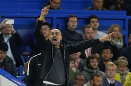 Manchester City's Spanish manager Pep Guardiola gestures on the touchline during the English Premier League football match between Chelsea and Manchester City at Stamford Bridge in London on September 30, 2017. / AFP PHOTO / Ian KINGTON / RESTRICTED TO EDITORIAL USE. No use with unauthorized audio, video, data, fixture lists, club/league logos or 'live' services. Online in-match use limited to 75 images, no video emulation. No use in betting, games or single club/league/player publications. /