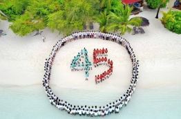 Staff of Kurumba Maldives on the island's beach in formation of the number 45 during the celebrations held to mark the resort's 45th Anniversary. PHOTO / KURUMBA MALDIVES