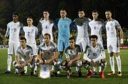 England's starting XI, (L-R top row) England's striker Marcus Rashford, England's defender Kieran Trippier, England's defender Michael Keane, England's goalkeeper Jack Butland, England's defender Harry Maguire, England's defender John Stones and England's midfielder Jordan Henderson and (L-R bottom row) England's defender Aaron Cresswell, England's striker Harry Kane, England's midfielder Harry Winks and England's midfielder Dele Alli during the 2018 FIFA World Cup European Qualifying football match between Lithuania and England at the LFF Stadium in Vilnius on October 8, 2017. / AFP PHOTO / Adrian DENNIS
