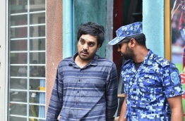 Police arrest Afrah Abdul Razzaq, 21, a suspect wanted in connection to the murder of Mohamed Anas. PHOTO: HUSSAIN WAHEED/MIHAARU