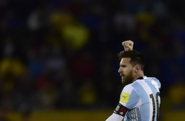 Argentina's Lionel Messi celebrates after scoring his third goal against Ecuador during their 2018 World Cup qualifier football match in Quito, on October 10, 2017. / AFP PHOTO / Rodrigo BUENDIA