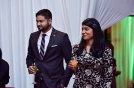 Amin Javed Faizal (L) with his wife, gender minister Zeneesha Zaki, pictured at the official Independence Day ceremony in July 2017. PHOTO: HUSSAIN WAHEED/MIHAARU