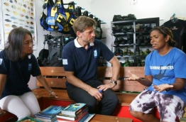 UNDP Representative to the Maldives Shoko Noda (L) and Nikolaj Coster-Waldau (M) with Maldives' first female diving course director Zoona (R). PHOTO / UNDP
