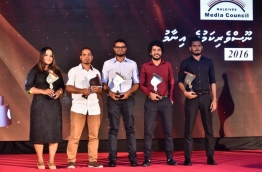 Journalism Awards' winners of Mihaaru pose for picture with their trophies (L-R): Aminath Mohamed Saeed (sister of Aasiyath Mohamed Saeed who accepted the award on the latter's behalf), Niumathullah Idrees, Ali Naafiz, Azzam Alifulhu and Muizzu Ibrahim. PHOTO: NISHAN ALI/MIHAARU