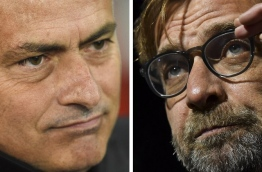 Jose Mourinho has described Liverpool's Anfield stadium as a 'beautiful place' and insisted his Manchester United stars will relish playing in such an intense atmosphere on October 14, 2017. / AFP PHOTO / Oli SCARFF AND Ben STANSALL