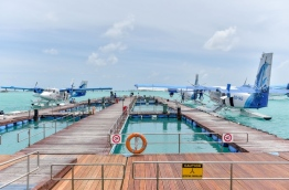 Seaplanes of Maldivian docked at Velana International Airport.