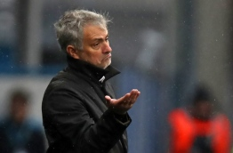 Manchester United's Portuguese manager Jose Mourinho gestures on the touchline during the English Premier League football match between Huddersfield Town and Manchester United at the John Smith's stadium in Huddersfield, northern England on October 21, 2017. / AFP PHOTO / Lindsey PARNABY / RESTRICTED TO EDITORIAL USE. No use with unauthorized audio, video, data, fixture lists, club/league logos or 'live' services. Online in-match use limited to 75 images, no video emulation. No use in betting, games or single club/league/player publications. /