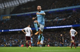 Manchester City's Argentinian defender Nicolas Otamendi celebrates scoring his team's second goal during the English Premier League football match between Manchester City and Burnley at the Etihad Stadium in Manchester, north west England, on October 21, 2017. / AFP PHOTO / Oli SCARFF / RESTRICTED TO EDITORIAL USE. No use with unauthorized audio, video, data, fixture lists, club/league logos or 'live' services. Online in-match use limited to 75 images, no video emulation. No use in betting, games or single club/league/player publications. /