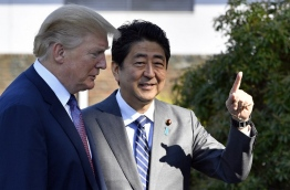 Trump touched down in Japan, kicking off the first leg of a high-stakes Asia tour set to be dominated by soaring tensions with nuclear-armed North Korea. / AFP PHOTO / POOL / FRANCK ROBICHON