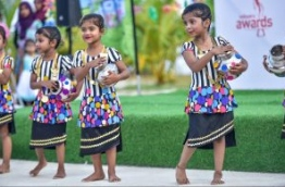 Children pictured performing a dance at the Sports Stars Fiesta in Maafushi. PHOTO: HUSSAIN WAHEED/MIHAARU