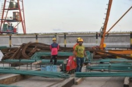 Staff of CCCC Second Harbour Engineering Company at work on the site of the Male-Hulhule bridge. PHOTO/MIHAARU