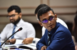 Finance minister Ahmed Munawar pictured at a meeting of the parliamentary budget review committee. PHOTO: HUSSAIN WAHEED/MIHAARU