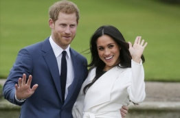Britain's Prince Harry will marry his US actress girlfriend Meghan Markle early next year after the couple became engaged earlier this month, Clarence House announced on Monday. / AFP PHOTO / Daniel LEAL-OLIVAS