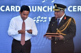 President Abdulla Yameen (L) launches the new Maldivian passport card. PHOTO/PRESIDENT'S OFFICE