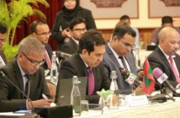 Economic Minister Mohamed Saeed (C) pictured at a free trade discussion.