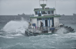 A local boat travels out of the Male harbour in rough seas. PHOTO: NISHAN ALI/MIHAARU