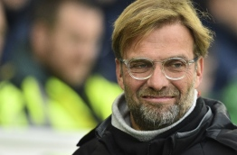 Liverpool's German manager Jurgen Klopp is seen ahead of kick off of the English Premier League football match between Brighton and Hove Albion and Liverpool at the American Express Community Stadium in Brighton, southern England on December 2, 2017. / AFP PHOTO / Glyn KIRK / RESTRICTED TO EDITORIAL USE. No use with unauthorized audio, video, data, fixture lists, club/league logos or 'live' services. Online in-match use limited to 75 images, no video emulation. No use in betting, games or single club/league/player publications. /