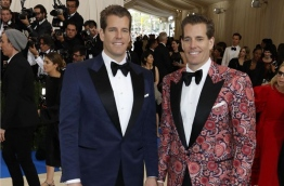 Tyler and Cameron Winklevoss - the Harvard University twins who famously sued Mark Zuckerberg claiming he stole their idea for Facebook - have become the world's first bitcoin billionaires. PHOTO: REUTERS