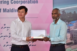 CMEC's legal representative Liu Xiaodo (L) hands over the 1,500 housing units the company developed in the Maldives to housing minister Dr Mohamed Muizzu. PHOTO/HOUSING MINISTRY