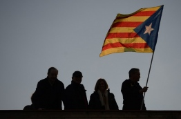 Lawmakers opted to split from Spain, claiming they had a mandate after a referendum on October 1 in which 90 percent of voters backed secession. / AFP PHOTO / Josep LAGO