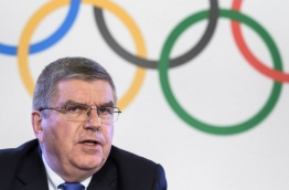 "Russia were banned from the 2018 Olympics on December 5 over state-sponsored doping but the International Olympic Committee said Russian competitors would be able to compete ""under strict conditions"". / AFP PHOTO / Fabrice COFFRINI"