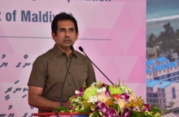Economic minister Mohamed Saeed at the ceremony in which CMEC handed over 1,500 flats to the Maldivian government. PHOTO: HUSSAIN WAHEED/MIHAARU