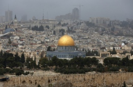 President Donald Trump is set to recognise Jerusalem as Israel's capital, upending decades of careful US policy and ignoring dire warnings from Arab and Western allies alike of a historic misstep that could trigger a surge of violence in the Middle East. / AFP PHOTO / AHMAD GHARABLI