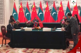 Maldives' president Abdulla Yameen and China's president Xi Jingping watch as Maldives' economic minister Mohamed Saeed and China's commerce minister Zhong Shan sign the free trade agreement between the Maldives and China. PHOTO/PRESIDENT'S OFFICE