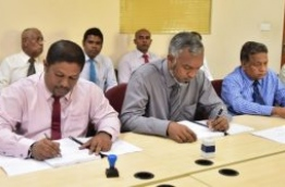 Former MRDC head Ibrahim Nazeem (L) pictured signing an agreement with the housing ministry.