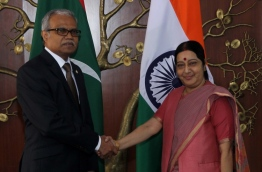 Maldives' foreign minister Dr Mohamed Asim (L) meets Indian foreign minister Sushma Swaraj.