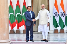 President Abdulla Yameen (L) meets Indian Prime Minister Narendra Modi during an official visit to India. PHOTO/MIHAARU