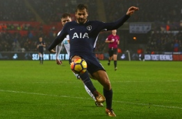 Tottenham Hotspur's Spanish striker Fernando Llorente controls the ball during the English Premier League football match between Swansea City and Tottenham Hotspur at The Liberty Stadium in Swansea, south Wales on January 2, 2018. / AFP PHOTO / Geoff CADDICK / RESTRICTED TO EDITORIAL USE. No use with unauthorized audio, video, data, fixture lists, club/league logos or 'live' services. Online in-match use limited to 75 images, no video emulation. No use in betting, games or single club/league/player publications. /
