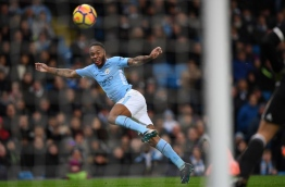 Manchester City's English midfielder Raheem Sterling heads wide during the English Premier League football match between Manchester City and Watford at the Etihad Stadium in Manchester, north west England, on January 2, 2018. / AFP PHOTO / Paul ELLIS / RESTRICTED TO EDITORIAL USE. No use with unauthorized audio, video, data, fixture lists, club/league logos or 'live' services. Online in-match use limited to 75 images, no video emulation. No use in betting, games or single club/league/player publications. /