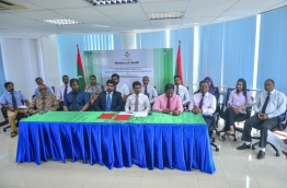 Officials of the Maldives' health ministry and India's NIMS Hospital at the signing ceremony awarding operations and development of Kulhudhuffushi Regional Hospital to the latter. PHOTO: HUSSAIN WAHEED/MIHAARU