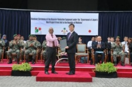 Parliamentary Vice-Minister for Foreign Affairs of Japan, Iwao Horii (R), presents disaster reduction equipment on behalf of the Japanese government to the Maldives, received by state defence minister Mohamed Zuhair. PHOTO/FOREIGN MINISTRY